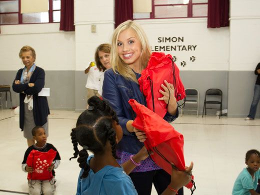 Giving Gracie|Gracie hands out some swag to Simon Elementary. Hey, can we get one of those?