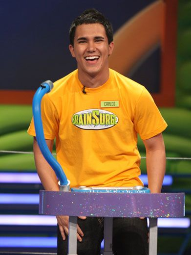 Surge-y Smile|Big Time Rush's Carlos flashes his pearly whites to the cameras before the games begin. He may be all smiles now, but he's got some serious surging to do.