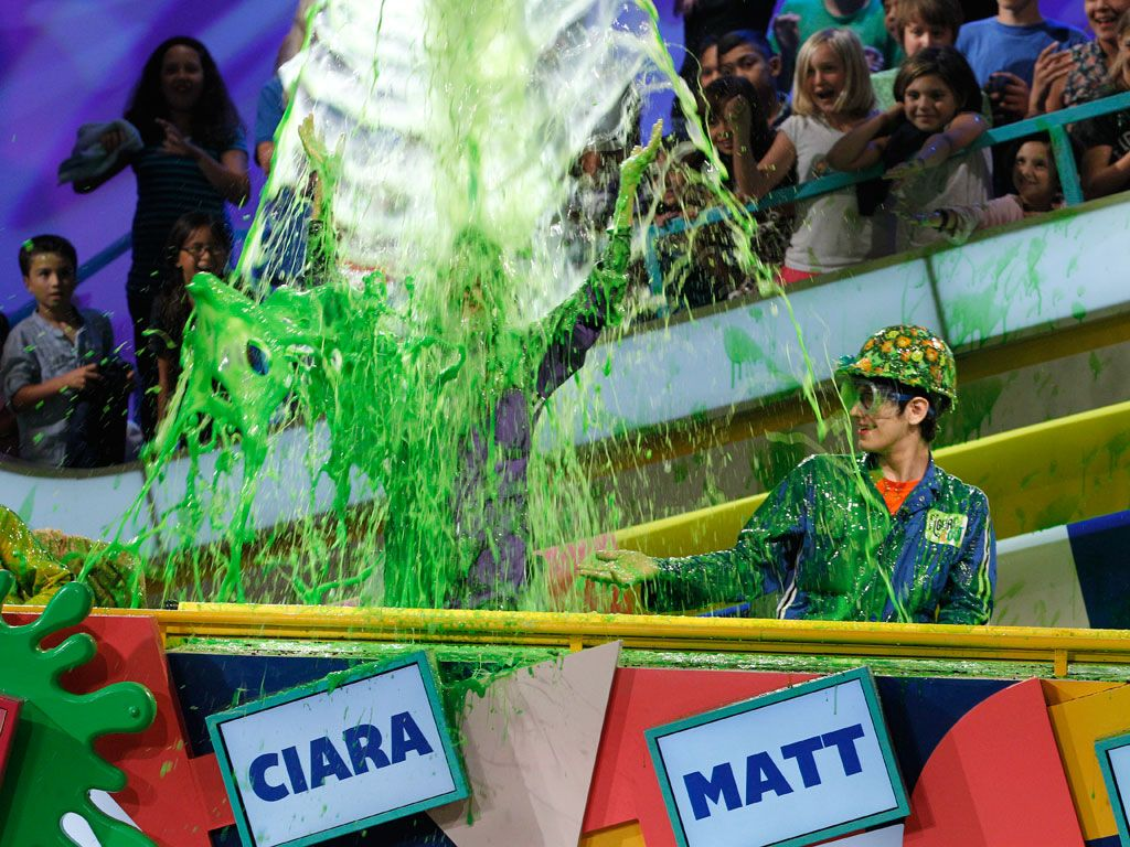 Queen of Slime|Ciara basks in gooey glory under this green waterfall. Looks so refreshing, even Matt wants some!