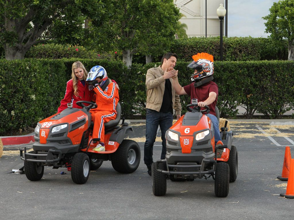 Pedal to the Metal|Our host Jeff Sutphen gives a high five to our lawnmower riding champion before his talent showcase.