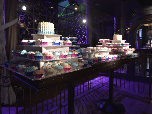Let Them Eat Cupcakes!|Cymph had multiple cakes at her party, including these cakes layered with cupcakes.