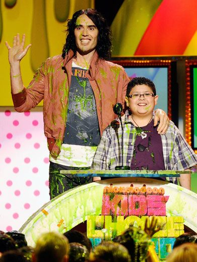 Grinning Green|Russell Brand and Rico Rodriguez were filled with slime-y smiles after getting a surprise slime attack by the audience.