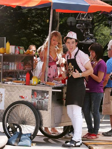 Silly Salesman|Is that Nick Jonas dressed up as a hotdog vendor?! Buy one for us, Tay-Tay!