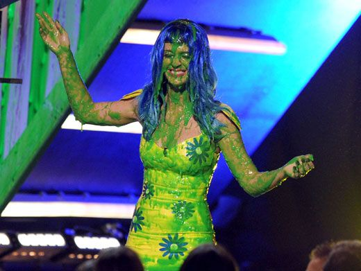 Goo-ey Grin|KP shoots a slime-y smile to the KCA audience.