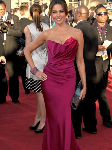 Fashionable Fuchsia|What's following Sofia Vergara on the red carpet? The train of her gorgeous pink gown!