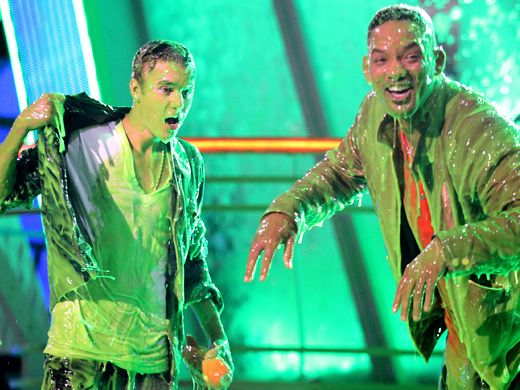 KCA 2012: Bieb Blast|There is nothing Will Smith can do to wipe the slime or the smile off his face after slop-bombing Justin Bieber.