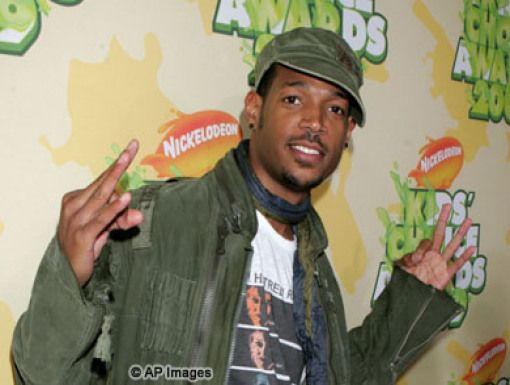 Marlon Wayans|Marlon Wayans hangs on the Orange Carpet before helping Dwayne Johnson with a special KCA assignment.
