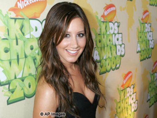 Ashley Tisdale|Ashley Tisdale poses on the Orange Carpet before