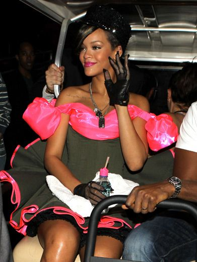 Rihanna|Before she rode a pink camo tank onstage, Rihanna scooted around behind the scenes in a VIP golf cart.