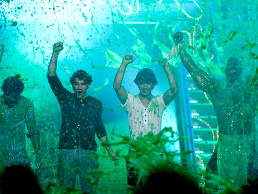 Three Times the Jonas...|Three times the slime. The Jonas Brothers get greened at the '09 KCAs.